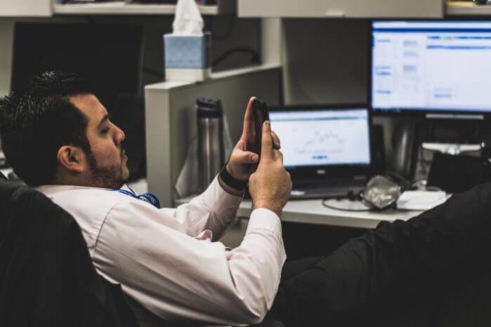 Man bored at work in the office