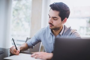 man-listing-down-things-to-avoid-when-quitting-job