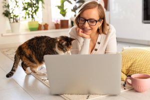 Woman with cat searching for internet-based-jobs