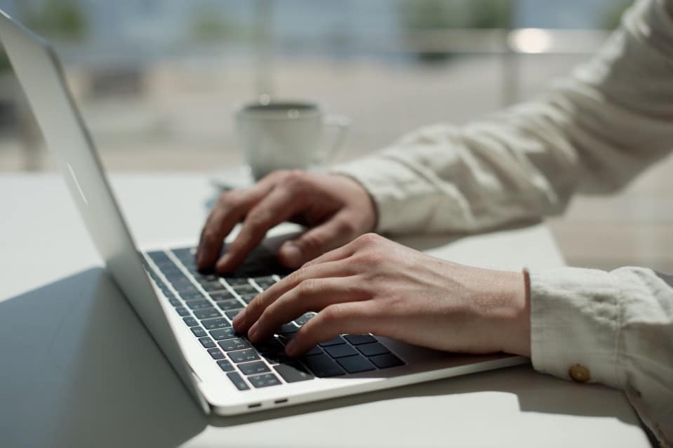Professional writing an effective resume on a laptop