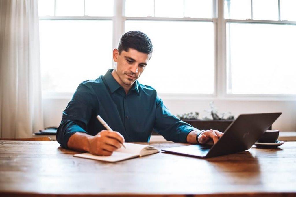 Man taking notes about resume writing