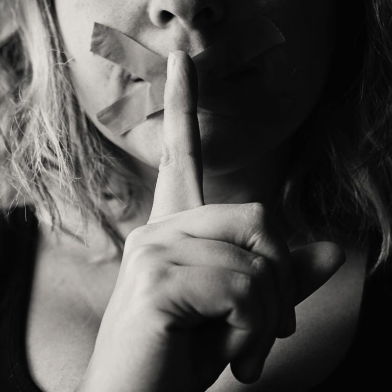 grayscale image of woman resume writer silencing to keep secrets to keyword optimization