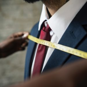 tailor measuring man's chest like custom resume writing