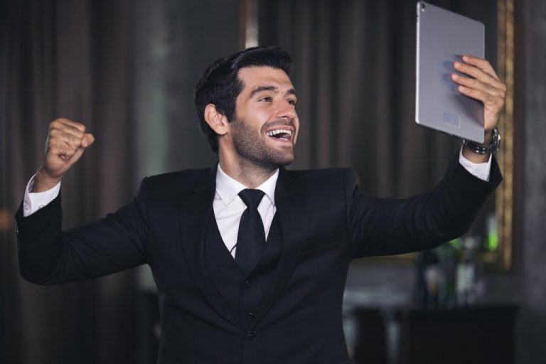 A happy employee holding a gadget