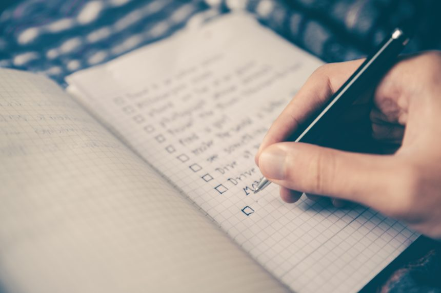 listing resume guidelines with checkboxes in a notebook