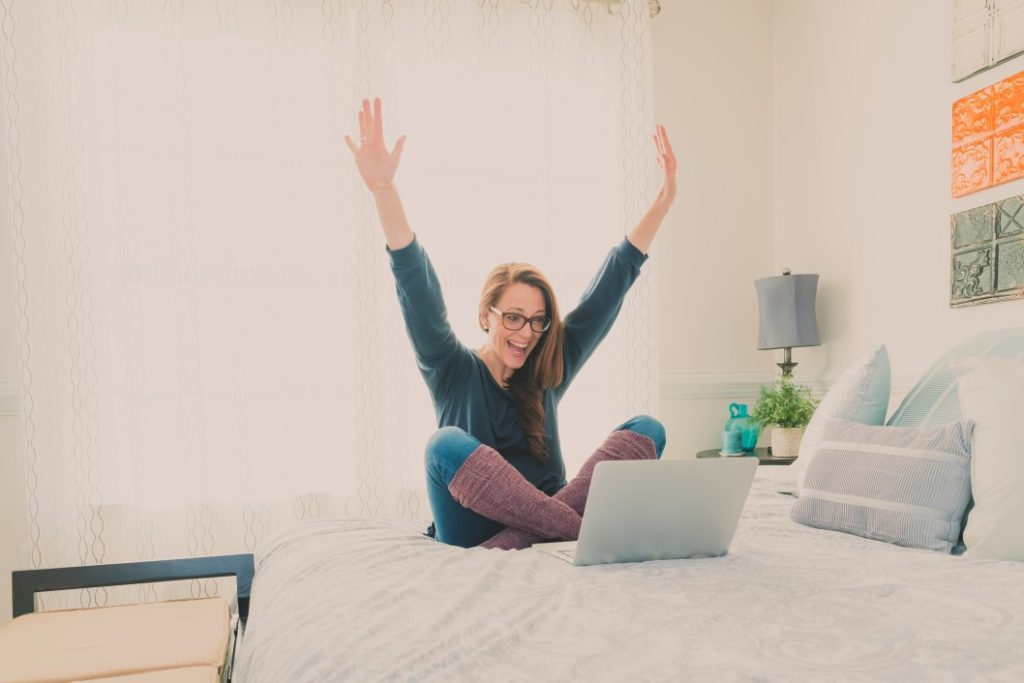 a happy positive woman raising her hands