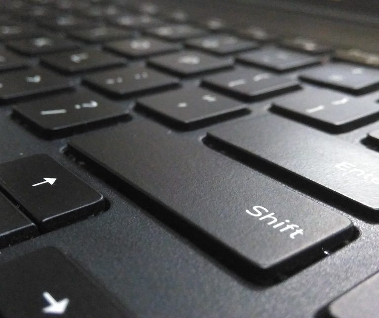 shift button from a laptop keyboard to represent perfect resume for career shifters