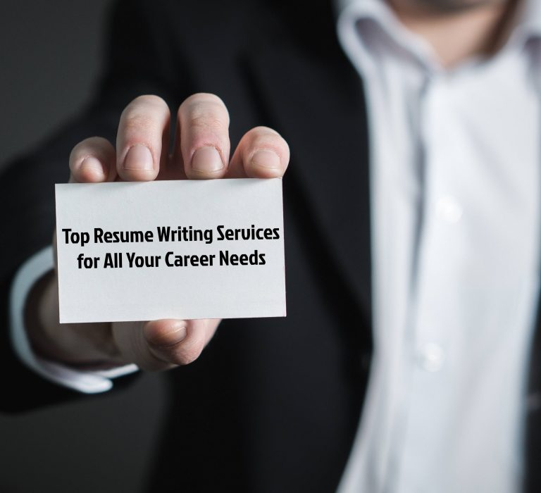 An employer holding a card saying Top Resume Writing Services for All Your Career Needs