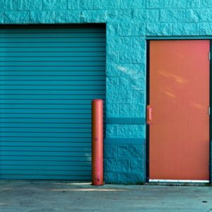 A blue door and a red door which represents the confusion between job or career