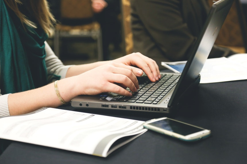 woman following writing guide for top IT resume