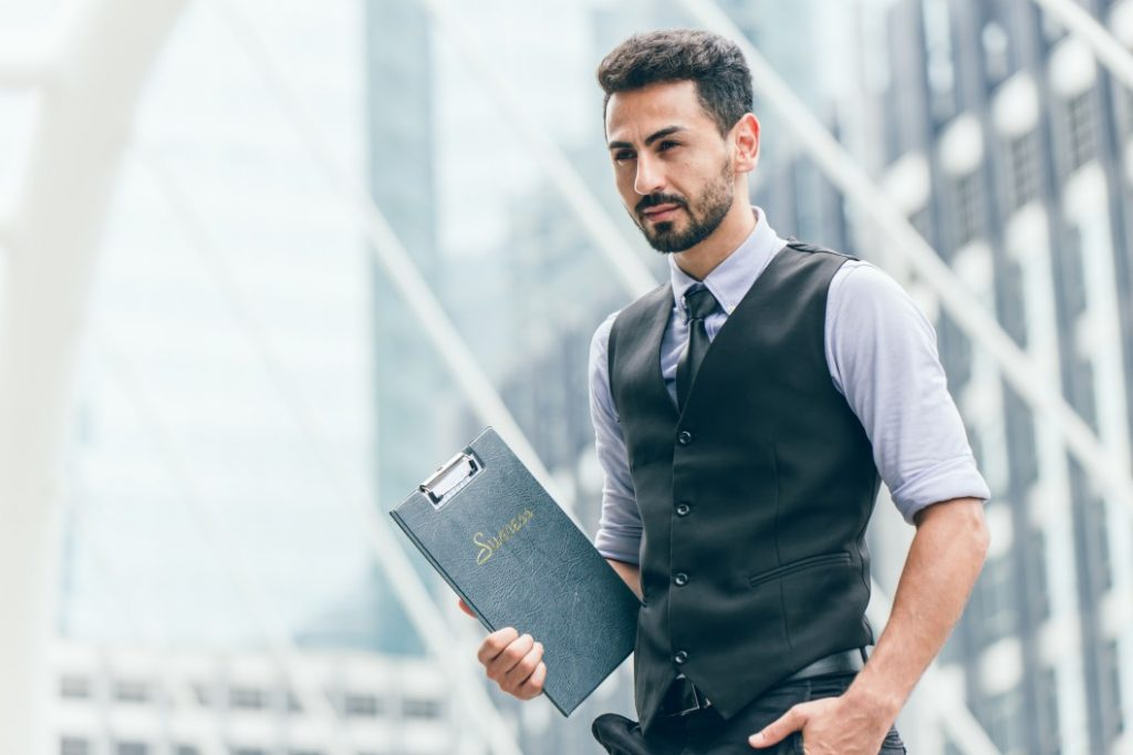 a person holding a folder and is determined to succeed despite job loss
