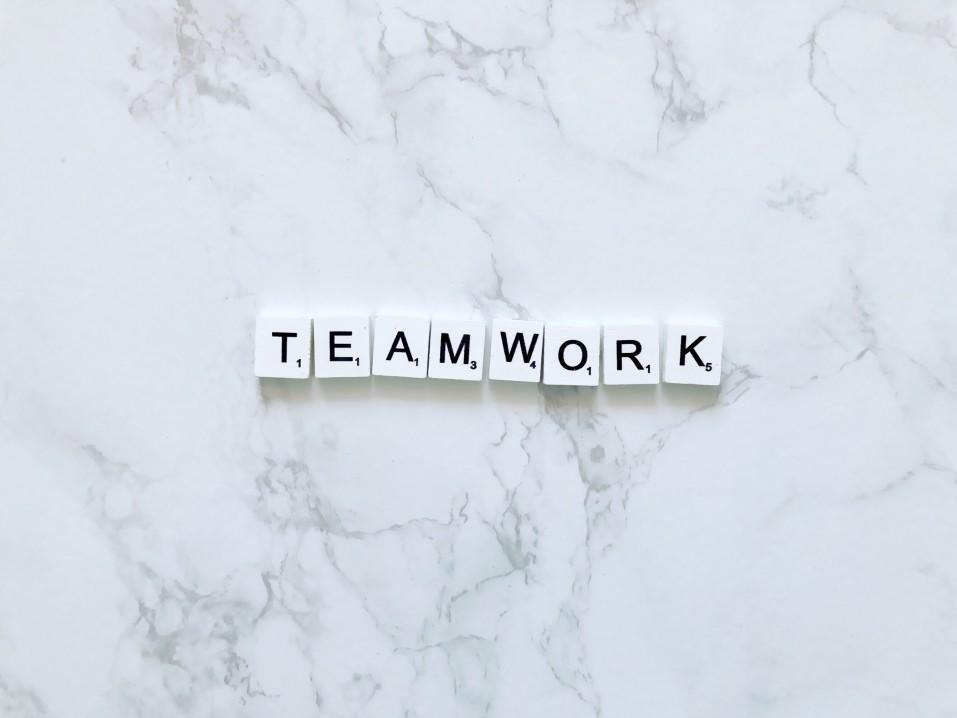 teamwork spelled using scrabble pieces