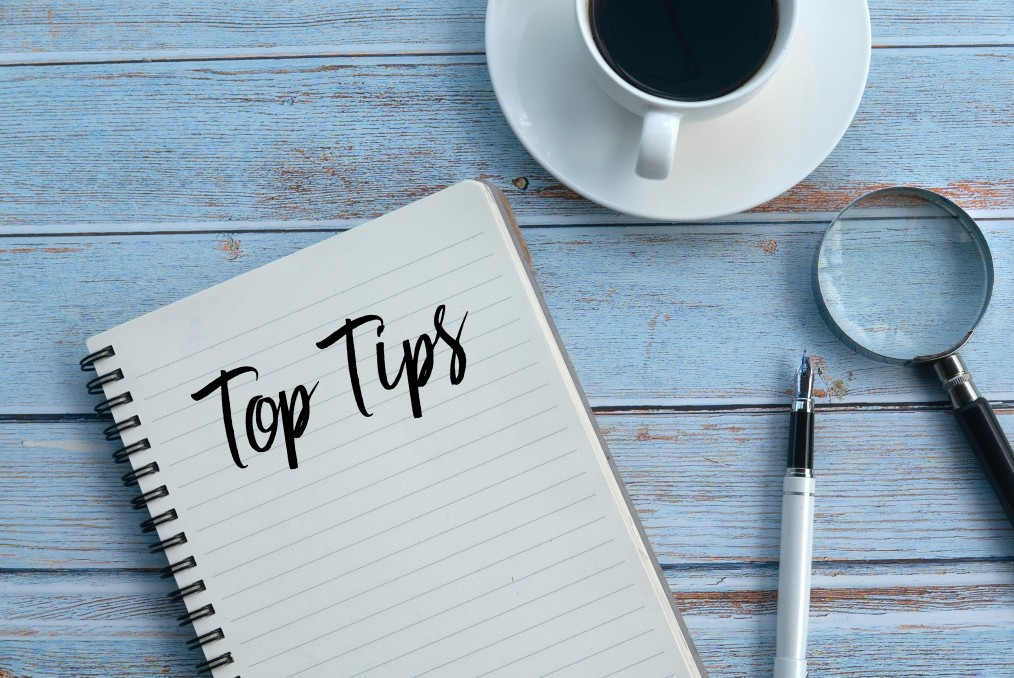 Top tips written on notebook for the best professional resume writing services