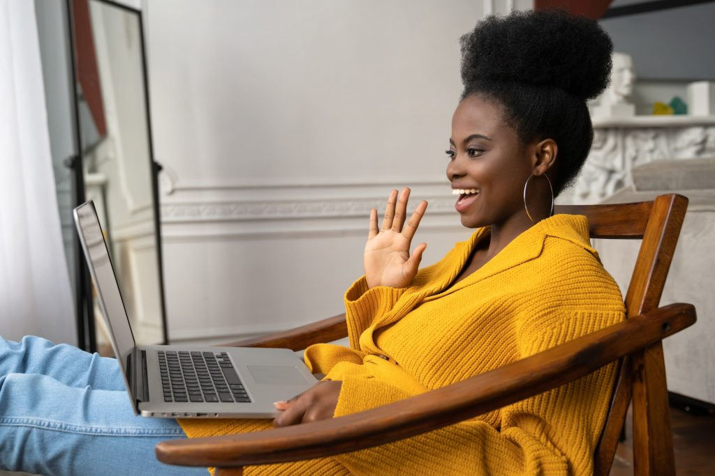 smiling woman engaging in online meeting with colleagues