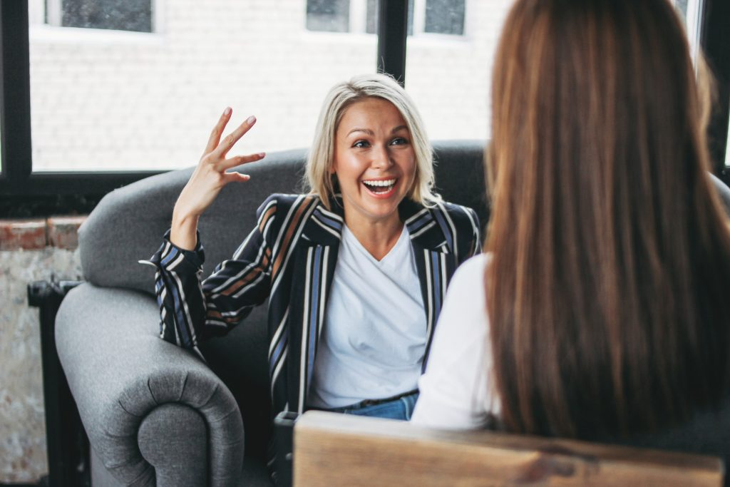 women engaging in interview coaching