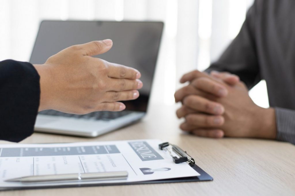 hiring manager ready to shake hands but the job applicant not yet