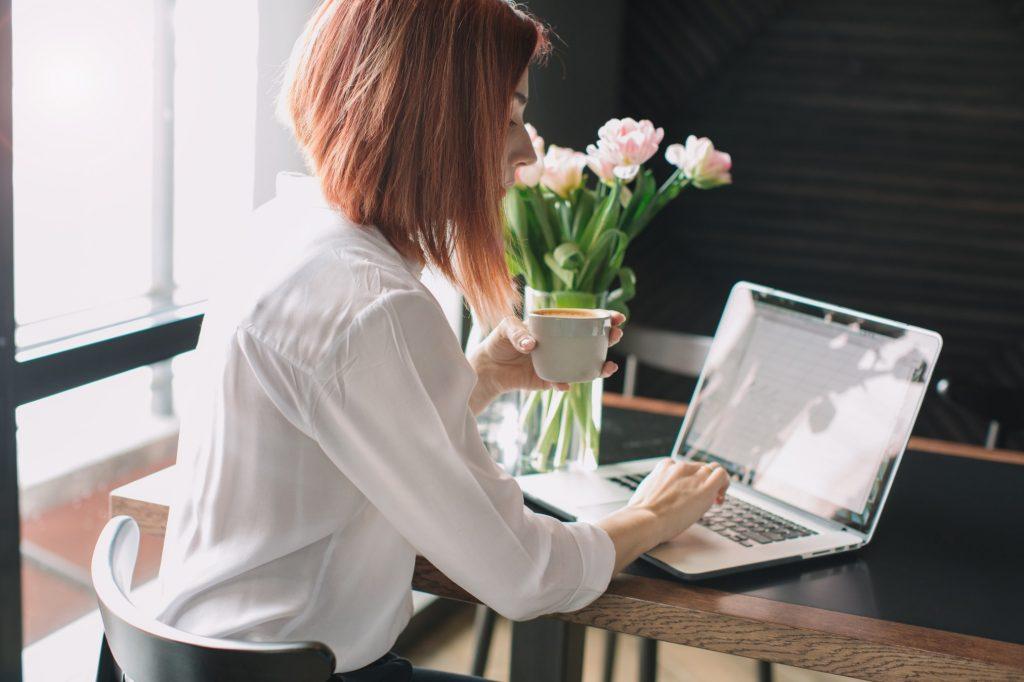job seeker typing a letter to decline a job offer
