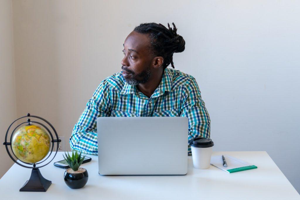 male job seeker thinking how to decline a job offer
