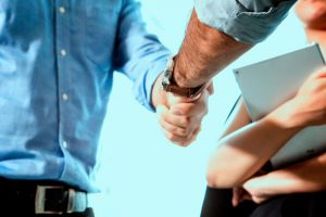 man shakes hand of colleague for the new job