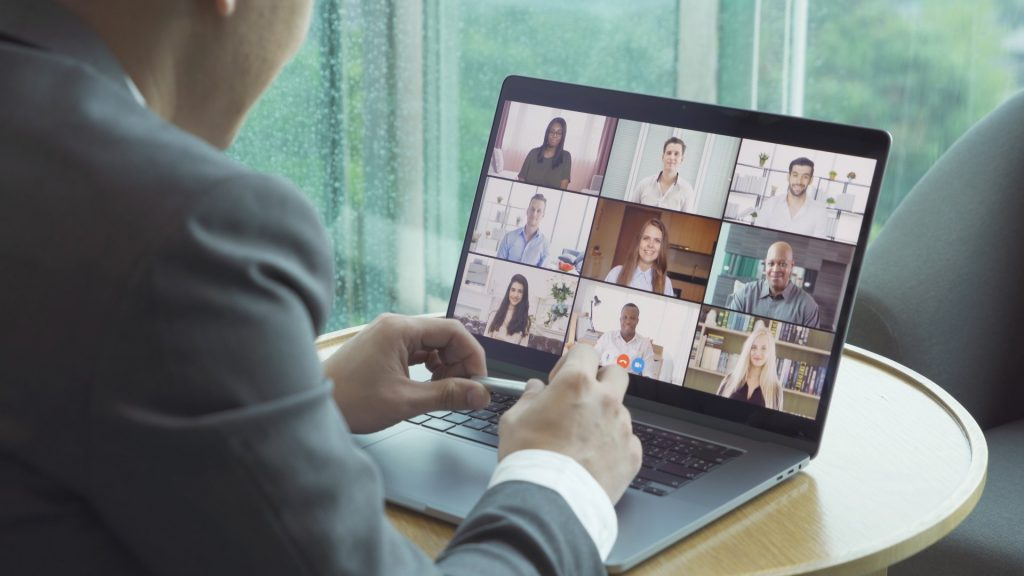 multiracial workers on video meeting