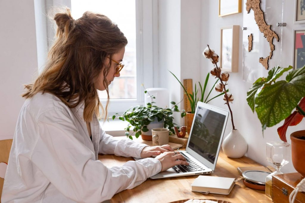 woman preparing for online job applications by updating her resume