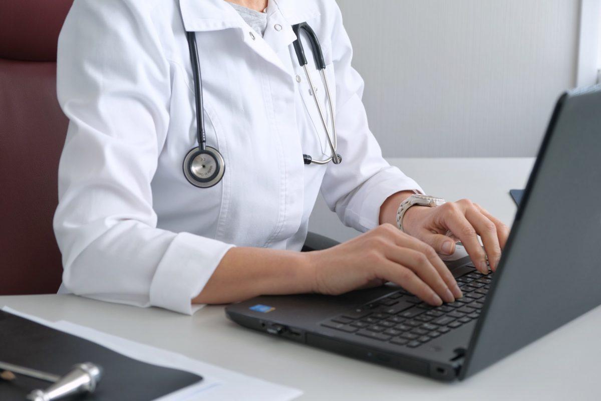 doctor updating her medical resume