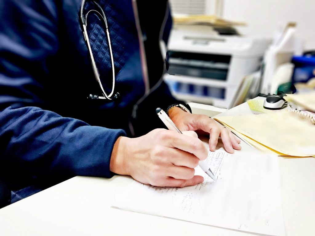 doctor wearing a stethoscope at work