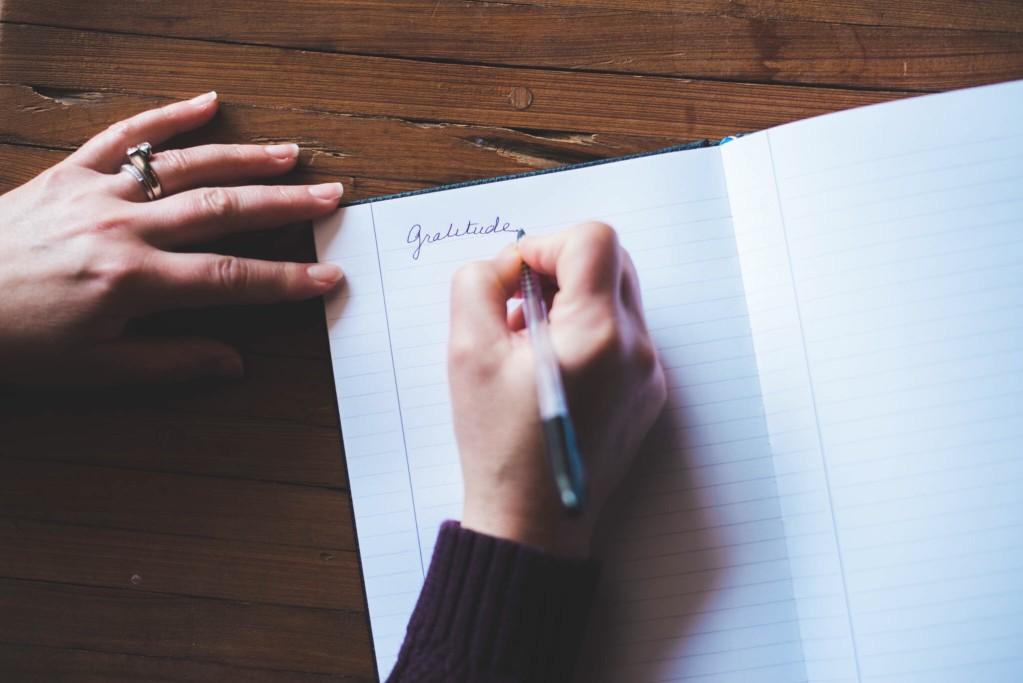 Job seeker writing thank-you letter after job interview