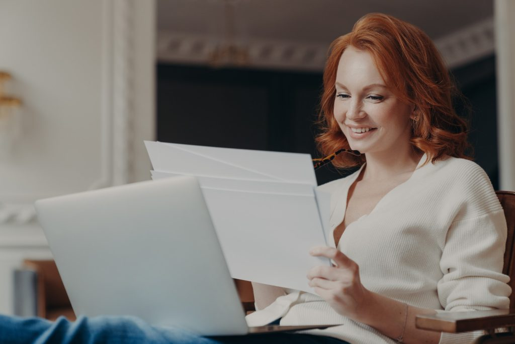 woman reviewing her printed resume